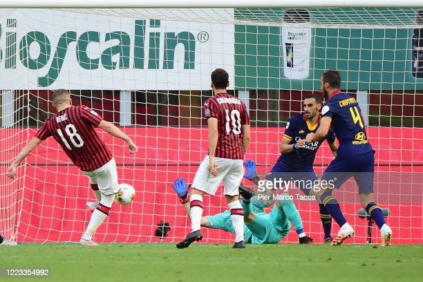 Ante Rebic of AC Milan scores his first goal during the Serie A match between AC Milan and AS Roma at Stadio Giuseppe Meazza on June 28 2020 in Milan...