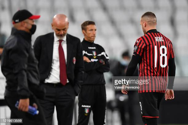 Ante Rebic of AC Milan walks off the pitch after being sent off during the Coppa Italia SemiFinal Second Leg match between Juventus and AC Milan at...