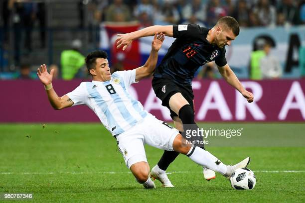 Ante Rebic of Croatia and Marcos Acuna of Argentina fight for the ball during the FIFA World Cup Group D match between Argentina and Croatia at...