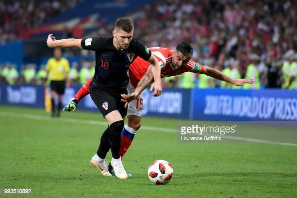 Ante Rebic of Croatia battles for possession with Alexander Samedov of Russia during the 2018 FIFA World Cup Russia Quarter Final match between...
