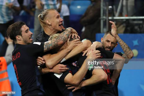 Ante Rebic of Croatia celebrates with teammates after scoring his team's first goal during the 2018 FIFA World Cup Russia group D match between...