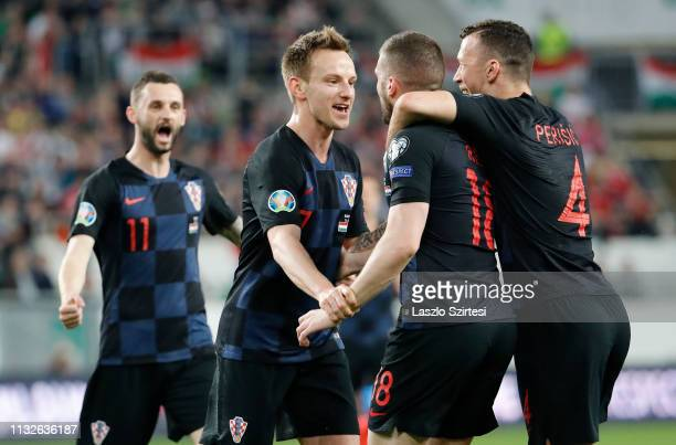 Ante Rebic of Croatia celebrates with teammates Marcelo Brozovic Ivan Rakitic and Ivan Perisic after scoring the opening goal during the 2020 UEFA...