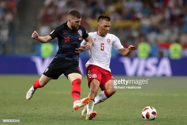 Ante Rebic of Croatia challenges Jonas Knudsen of Denmark during the 2018 FIFA World Cup Russia Round of 16 match between Croatia and Denmark at...