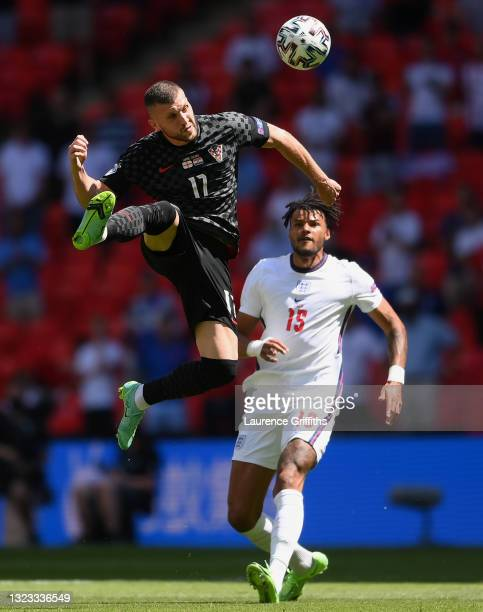 Ante Rebic of Croatia competes for a header with Tyrone Mings of England during the UEFA Euro 2020 Championship Group D match between England and...