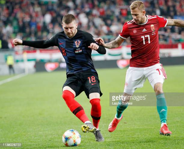 Ante Rebic of Croatia competes for the ball with Roland Varga of Hungary during the 2020 UEFA European Championships group E qualifying match between...