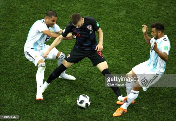 Ante Rebic of Croatia fouls Eduardo Salvio of Argentina under pressure from Gabriel Mercado of Argentina leading to Ante Rebic of Croatia recieving a...