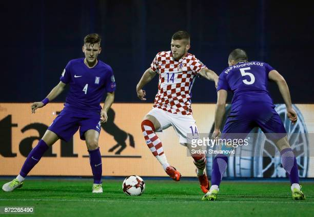 Ante Rebic of Croatia in action against Kyriakos Papadopoulos and Panagiotis Retsos of Greece during the FIFA 2018 World Cup Qualifier PlayOff First...