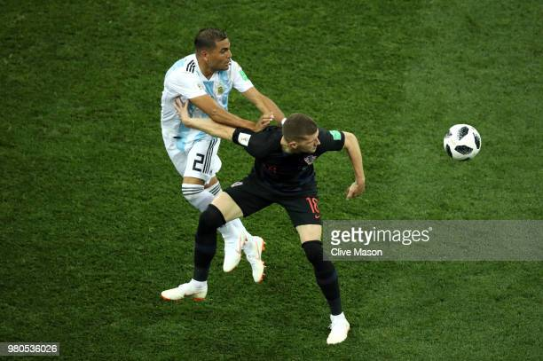 Ante Rebic of Croatia is challenged by Gabriel Mercado of Argentina during the 2018 FIFA World Cup Russia group D match between Argentina and Croatia...