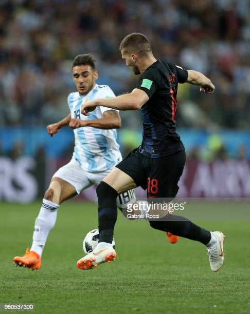 Ante Rebic of Croatia is tackled by Eduardo Salvio of Argentina during the 2018 FIFA World Cup Russia group D match between Argentina and Croatia at...