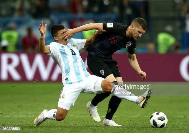 Ante Rebic of Croatia is tackled by Marcos Acuna of Argentina during the 2018 FIFA World Cup Russia group D match between Argentina and Croatia at...