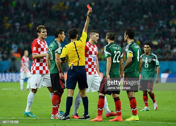 Ante Rebic of Croatia receives a red card during the 2014 FIFA World Cup Brazil Group A match between Croatia and Mexico at Arena Pernambuco on June...