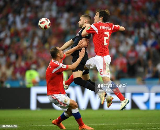 Ante Rebic of Croatia stops the ball under pressure from Mario Fernandes of Russia during the 2018 FIFA World Cup Russia Quarter Final match between...
