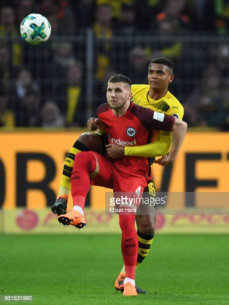 Ante Rebic of Eintracht Frankfurt and Manuel Akanji of Borussia Dortmund compete for the ball during the Bundesliga match between Borussia Dortmund...