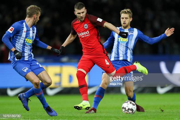 Ante Rebic of Eintracht Frankfurt battles for possession with Fabian Lustenberger of Hertha Berlin and Arne Maier of Hertha Berlin during the...