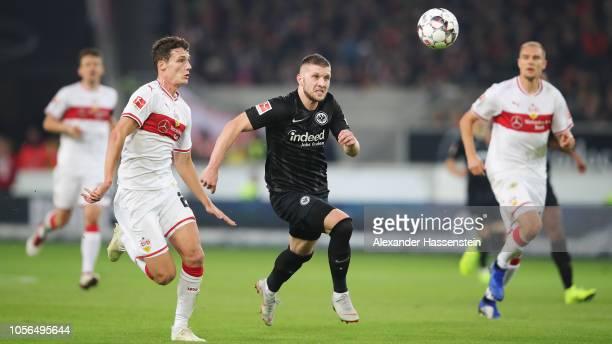 Ante Rebic of Eintracht Frankfurt battles for the ball with Benjamin Pavard of VfB Stuttgart during the Bundesliga match between VfB Stuttgart and...