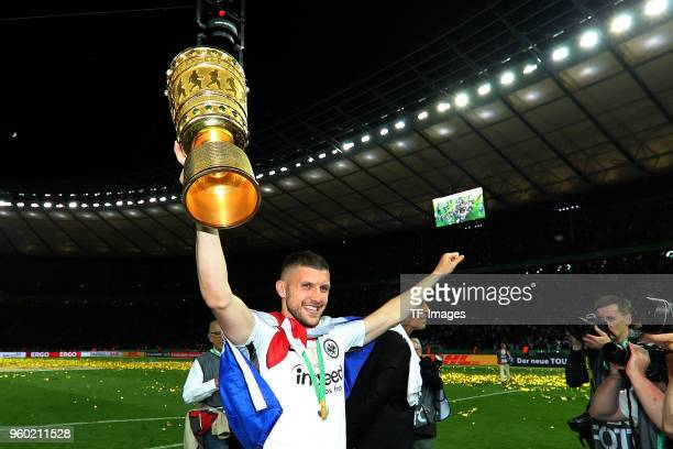 Ante Rebic of Eintracht Frankfurt celebrates with the trophy after winning the DFB Cup final between Bayern Muenchen and Eintracht Frankfurt at...
