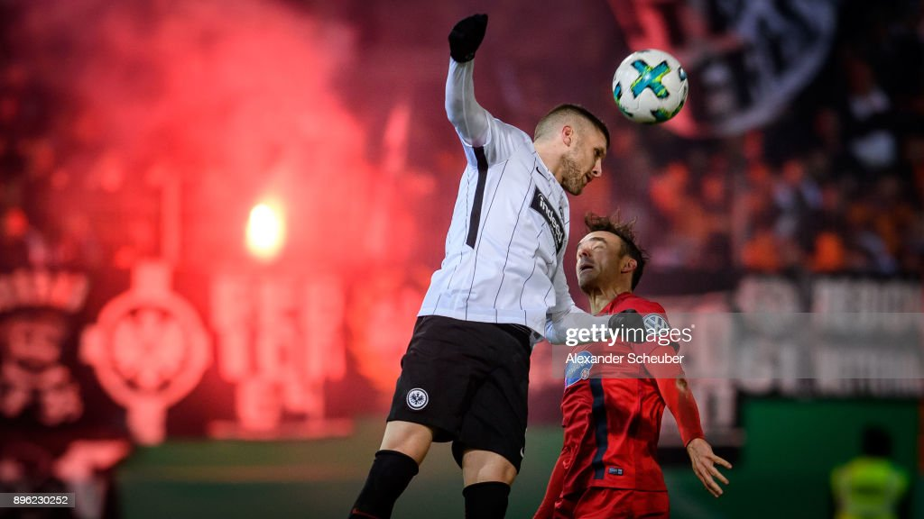 Ante Rebic of Eintracht Frankfurt in action against Robert Strauss of Heidenheim during the DFB Cup match between 1. FC Heidenheim and Eintracht Frankfurt at Voith-Arena on December 20, 2017 in Heidenheim, Germany.