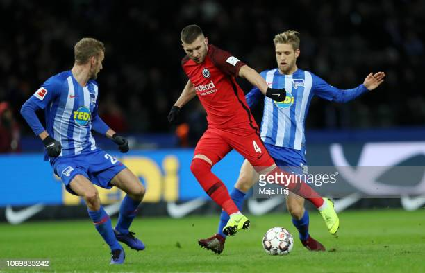Ante Rebic of Eintracht Frankfurt is challenged by Fabian Lustenberger and Arne Maier of Hertha BSC during the Bundesliga match between Hertha BSC...