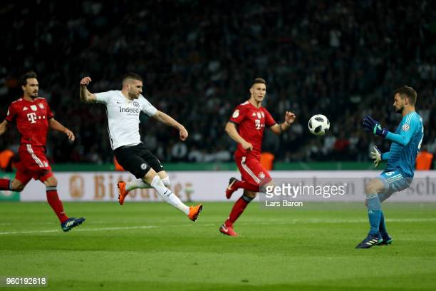 Ante Rebic of Eintracht Frankfurt scores his teams second goal past goalkeeper Sven Ulreich of Bayern Muenchen during the DFB Cup final between...