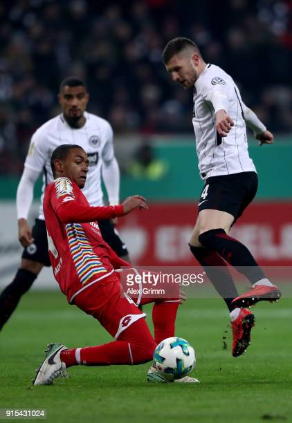 Ante Rebic of Frankfurt and Abdou Diallo of Mainz battle for the ball during the DFB Cup quarter final match between Eintracht Frankfurt and 1 FSV...