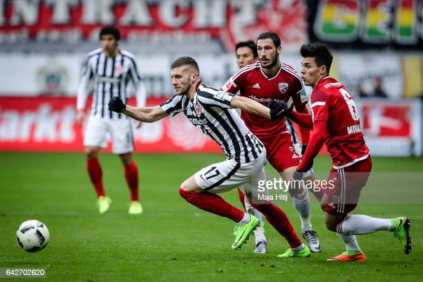 Ante Rebic of Frankfurt and Alfredo Morales of Ingolstadt battle for the ball during the Bundesliga match between Eintracht Frankfurt and FC...