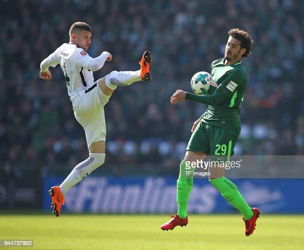 Ante Rebic of Frankfurt and Ishak Belfodil of Bremen battle for the ball during the Bundesliga match between Werder Bremen and Eintracht Frankfurt at...