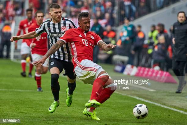 Ante Rebic of Frankfurt and Jerome Boateng of Muenchen battle for the ball during the Bundesliga match between Bayern Muenchen and Eintracht...