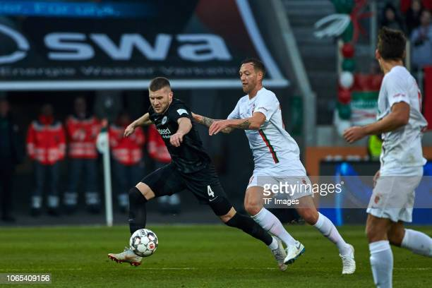 Ante Rebic of Frankfurt and Julian Schieber of Augsburg battle for the ball during the Bundesliga match between FC Augsburg and Eintracht Frankfurt...
