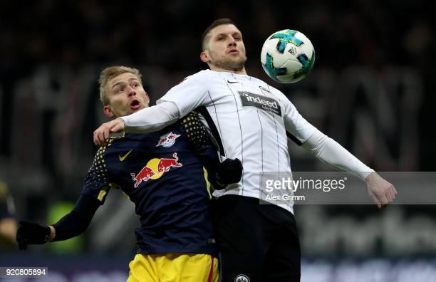 Ante Rebic of Frankfurt and Konrad Laimer of Leipzig battle for the ball during the Bundesliga match between Eintracht Frankfurt and RB Leipzig at...