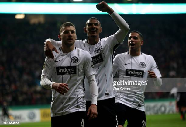 Ante Rebic of Frankfurt celebrates after he scores the opening goal during the DFB Cup quarter final match between Eintracht Frankfurt and 1 FSV...