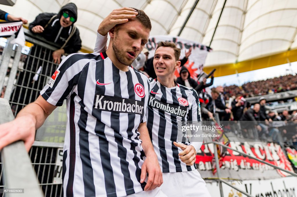 Ante Rebic of Frankfurt celebrates the third goal for his team with Guillermo Varela of Frankfurt during the Bundesliga match between Eintracht Frankfurt and FC Augsburg at Commerzbank-Arena on April 22, 2017 in Frankfurt am Main, Germany.