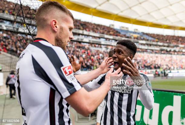 Ante Rebic of Frankfurt celebrates the third goal for his team with his teammate during the Bundesliga match between Eintracht Frankfurt and FC...