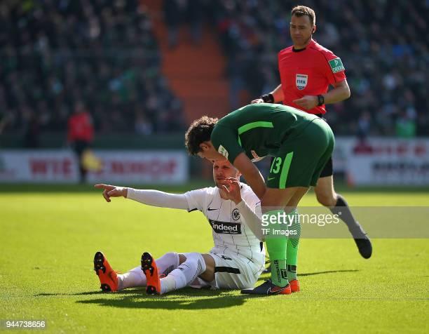 Ante Rebic of Frankfurt gestures and Milos Veljkovic of Bremen looks on during the Bundesliga match between Werder Bremen and Eintracht Frankfurt at...