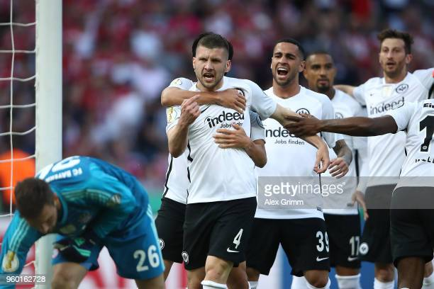 Ante Rebic of Frankfurt is celebrated by his team after he scored a goal to make it 0:1 during the DFB Cup final between Bayern Muenchen and...