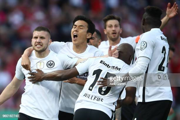 Ante Rebic of Frankfurt is celebrated by his team after he scored a goal to make it 01 during the DFB Cup final between Bayern Muenchen and Eintracht...