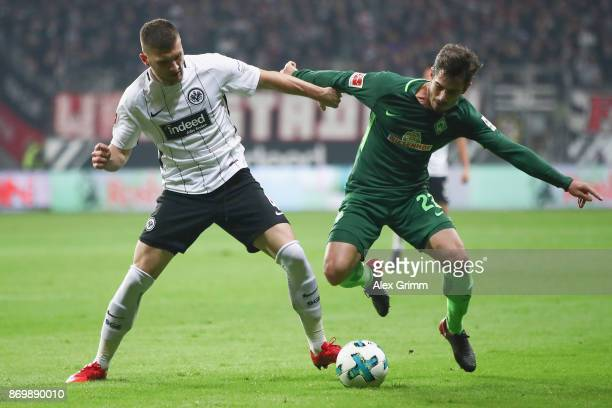 Ante Rebic of Frankfurt is challenged by Fin Bartels of Bremen during the Bundesliga match between Eintracht Frankfurt and SV Werder Bremen at...