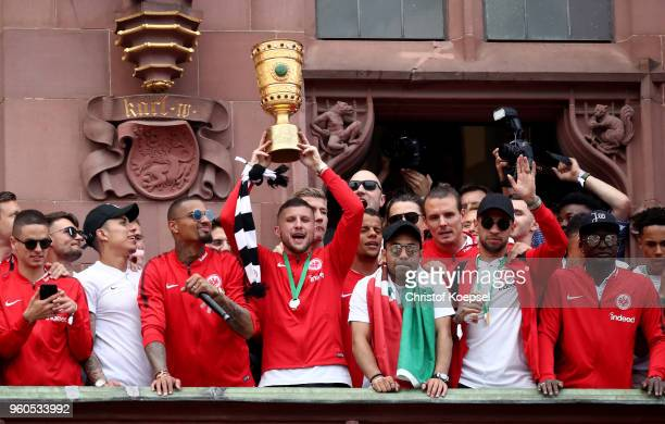 Ante Rebic of Frankfurt list the German Cup trophy at the Roemer on May 20 2018 in Frankfurt am Main Germany