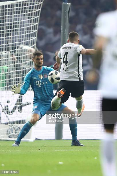 Ante Rebic of Frankfurt scores a goal past goalkeeper Sven Ulreich of Bayern Muenchen during the DFB Cup final between Bayern Muenchen and Eintracht...