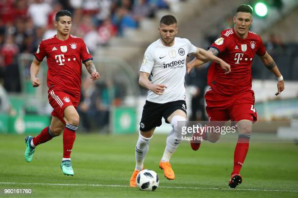Ante Rebic of Frankfurt scores a goal to make it 01 as Niklas Suele of Bayern Muenchen can't stop him during the DFB Cup final between Bayern...