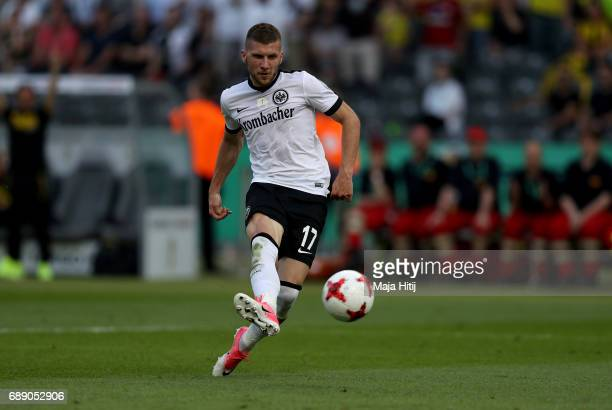 Ante Rebic of Frankfurt scores his team's first goal during the DFB Cup final match between Eintracht Frankfurt and Borussia Dortmund at...