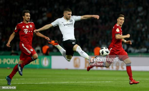 Ante Rebic of Frankfurt scores his teams second goal next to Mats Hummels of Bayern Muenchen and Niklas Suele of Bayern during the DFB Cup final...
