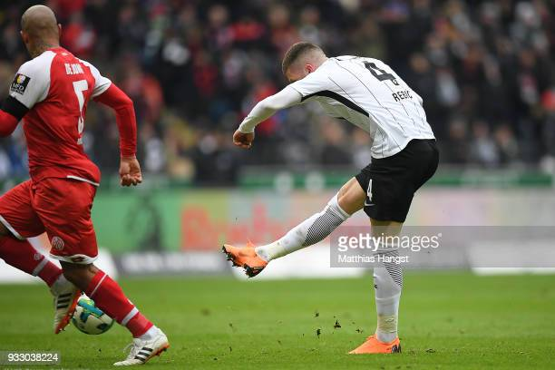 Ante Rebic of Frankfurt shoots on target to score a goal to make it 30 during the Bundesliga match between Eintracht Frankfurt and 1 FSV Mainz 05 at...