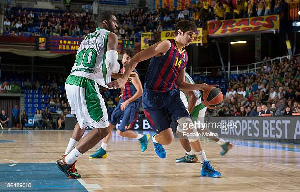 Ante Tomic #44 of FC Barcelona competes with Will Daniels #40 of JSF Nanterre during the 20132014 Turkish Airlines Euroleague Regular Season Date 3...