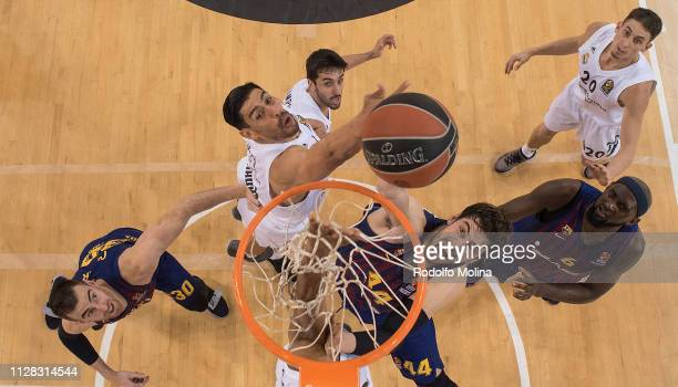 Ante Tomic #44 of FC Barcelona Lassa competes with Gustavo Ayon #14 of Real Madrid during the 2018/2019 Turkish Airlines EuroLeague Regular Season...