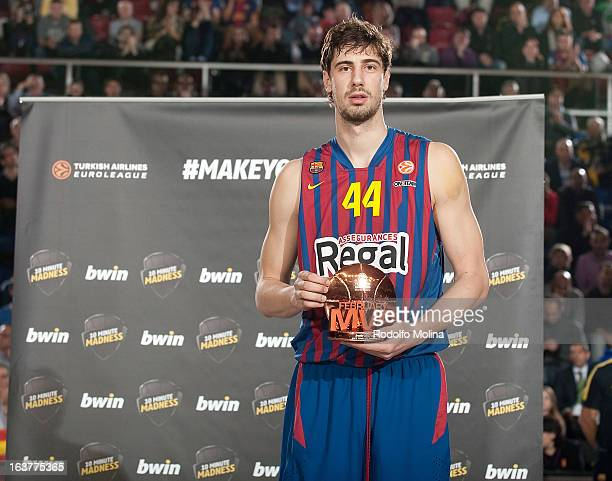 Ante Tomic #44 of FC Barcelona Regal poses with the bwin MVP February trophy during the 20122013 Turkish Airlines Euroleague Top 16 Date 11 between...