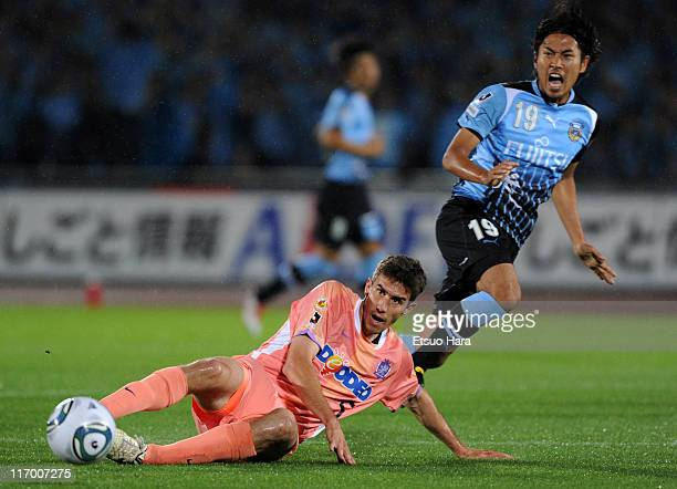 Ante Tomic of Sanfrecce Hiroshima tackles Kosei Shibasaki of Kawasaki Frontale during the JLeague match between Kawasaki Frontale and Sanfrecce...