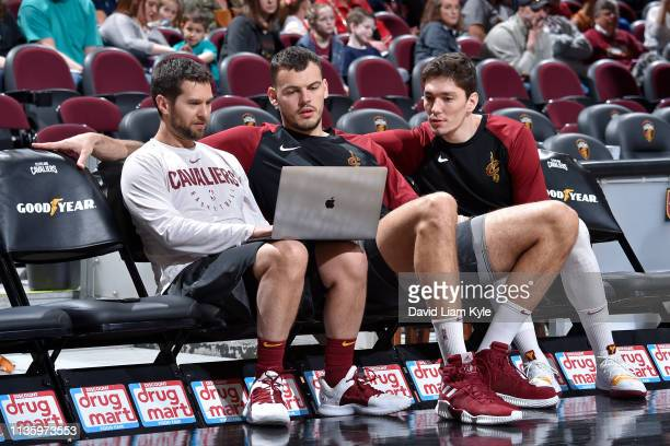 Ante Zizic and Cedi Osman of the Cleveland Cavaliers review material prior to the game against the San Antonio Spurs on April 7 2019 at Quicken Loans...