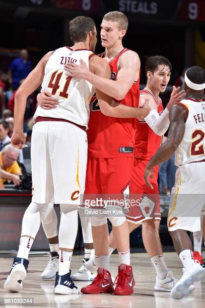 Ante Zizic of the Cleveland Cavaliers and Lauri Markkanen of the Chicago Bulls react after the pre season game on October 10 2017 at Quicken Loans...