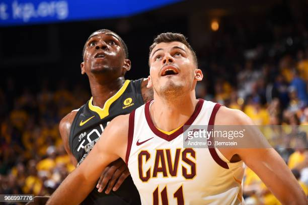 Ante Zizic of the Cleveland Cavaliers boxes out Kevon Looney of the Golden State Warriors in Game Two of the 2018 NBA Finals on June 3 2018 at ORACLE...