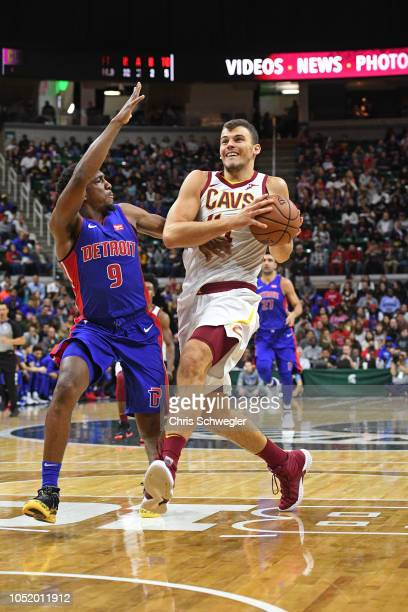 Ante Zizic of the Cleveland Cavaliers drives to the basket against the Detroit Pistons during a preseason game on October 12 2018 at Breslin Student...